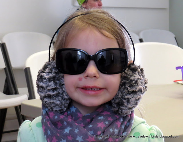 girl with oversized sunglasses and earmuffs