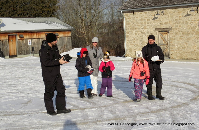 group of adults and children in winter gear outside