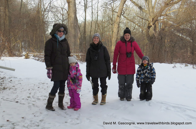 group standing on winter trail