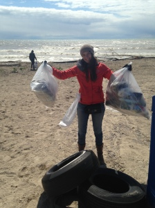 Rhiannon with garbage bags full of plastic collected on the beach